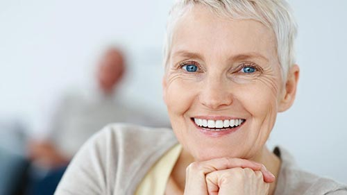 Senior woman smiling small